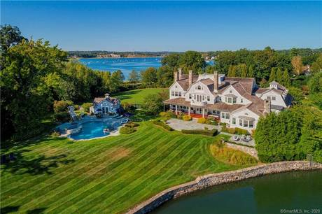 Luxury Mansion For Sale in Greenwich CT 06878. Big colonial house near waterfront with swimming pool and 5 car garage.