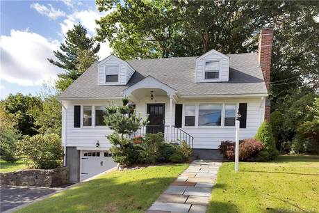 Single Family Home Sold in Stamford CT 06905.  cape cod house near beach side waterfront with 1 car garage.