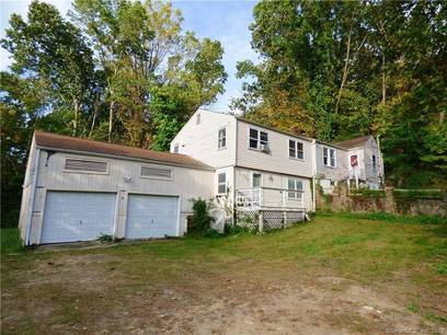 Single Family Home Sold in Brookfield CT 06804. Old ranch house near waterfront with 2 car garage.