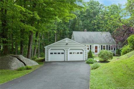 Single Family Home Sold in Ridgefield CT 06877.  cape cod house near river side waterfront with 2 car garage.