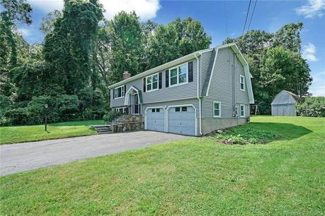 Single Family Home For Sale in Shelton CT 06484. Ranch house near waterfront with 2 car garage.