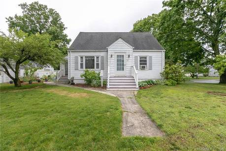 Single Family Home For Sale in Stratford CT 06614.  cape cod house near beach side waterfront with 1 car garage.