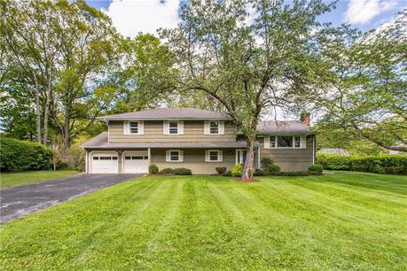 Single Family Home Sold in Norwalk CT 06851.  house near beach side waterfront with 2 car garage.