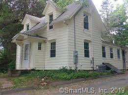 Single Family Home For Sale in Trumbull CT 06611. Old  cape cod house near waterfront with 2 car garage.