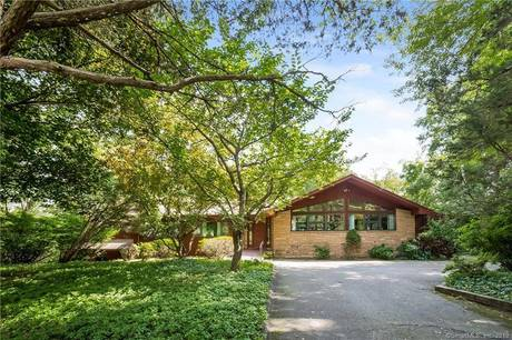 Single Family Home Sold in Westport CT 06880. Contemporary house near river side waterfront with swimming pool and 2 car garage.