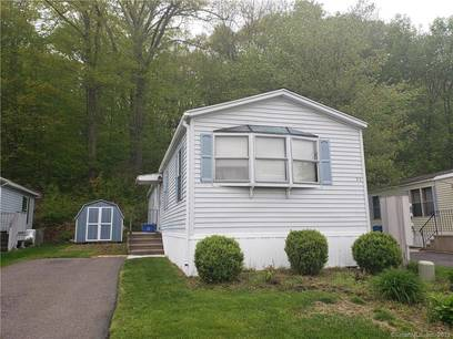 Single Family Home Sold in Shelton CT 06484.  mobile-home house near waterfront with 2 car garage.