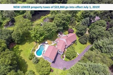 Single Family Home Sold in Wilton CT 06897. Colonial house near river side waterfront with swimming pool and 4 car garage.