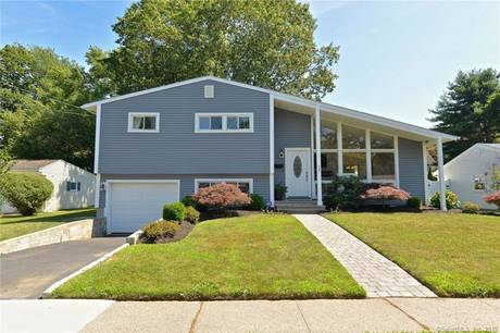 Single Family Home Sold in Stratford CT 06614.  house near beach side waterfront with 1 car garage.