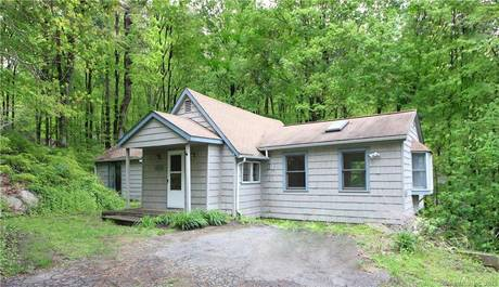 Single Family Home Sold in Weston CT 06883. Old ranch house near waterfront.