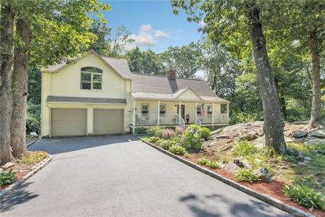 Single Family Home Sold in Monroe CT 06468. Colonial cape cod house near waterfront with 2 car garage.