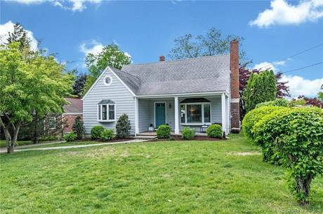 Single Family Home Sold in Darien CT 06820.  cape cod house near beach side waterfront with 2 car garage.