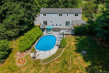 Single Family Home Sold in Danbury CT 06811. Contemporary house near lake side waterfront with swimming pool and 2 car garage.