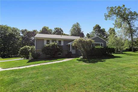 Single Family Home Sold in Ridgefield CT 06877.  house near waterfront with 2 car garage.
