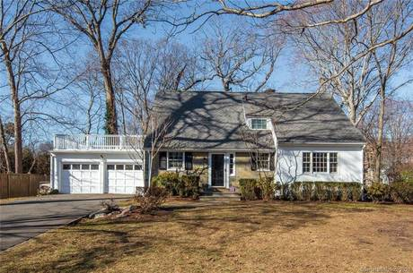 Single Family Home Sold in Darien CT 06820.  cape cod house near lake side waterfront with 2 car garage.