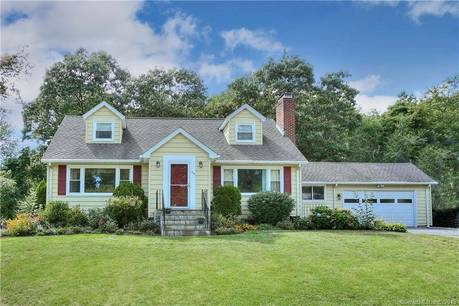 Single Family Home Sold in Bridgeport CT 06606.  cape cod house near lake side waterfront with 2 car garage.