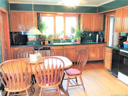 Single Family Home For Sale in Norwalk CT 06850. Old colonial house near beach side waterfront with 1 car garage.