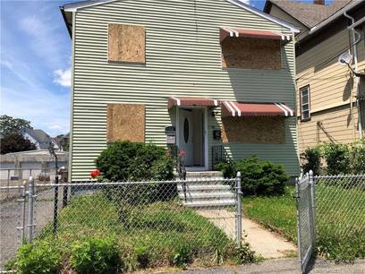 Foreclosure: Multi Family Home Sold in Bridgeport CT 06606.  house near waterfront with 2 car garage.