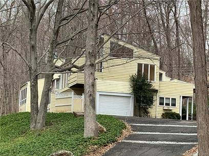 Single Family Home Sold in Wilton CT 06897. Contemporary house near waterfront with 1 car garage.