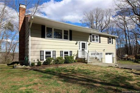 Single Family Home Sold in Wilton CT 06897. Ranch house near lake side waterfront with 2 car garage.