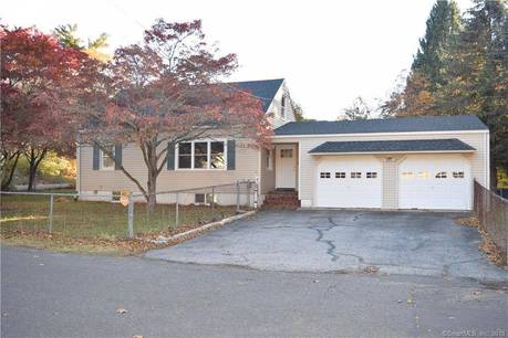 Single Family Home Sold in Bridgeport CT 06610.  cape cod house near waterfront with 2 car garage.