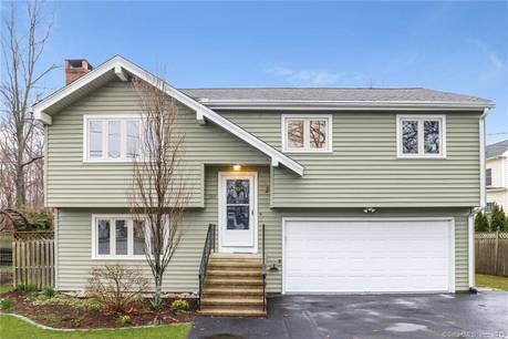 Single Family Home Sold in Fairfield CT 06824. Ranch house near beach side waterfront with 22 car garage.