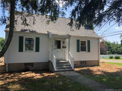 Single Family Home Sold in Trumbull CT 06611.  cape cod house near waterfront with 2 car garage.