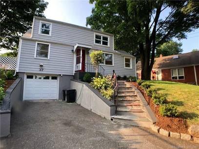 Single Family Home Sold in Norwalk CT 06854.  cape cod house near waterfront with 1 car garage.