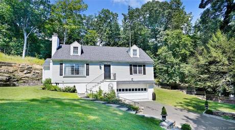 Single Family Home Sold in Greenwich CT 06830.  cape cod house near beach side waterfront with 2 car garage.