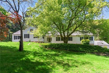 Single Family Home Sold in Darien CT 06820. Ranch house near beach side waterfront with swimming pool and 2 car garage.