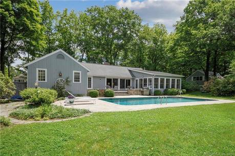 Single Family Home Sold in Wilton CT 06897. Ranch house near waterfront with swimming pool and 2 car garage.