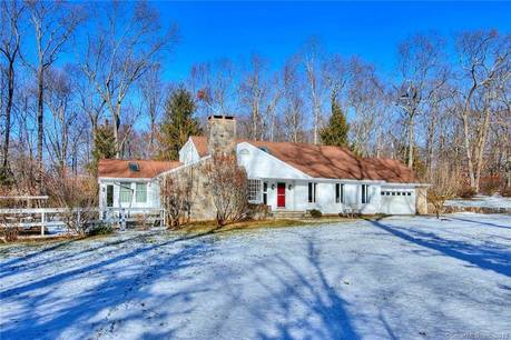 Single Family Home Sold in Weston CT 06883.  cape cod house near waterfront with swimming pool and 2 car garage.