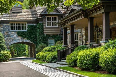 Luxury Mansion Sold in Greenwich CT 06831. Big colonial house near waterfront with swimming pool and 6 car garage.