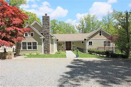 Single Family Home Sold in Ridgefield CT 06877.  cape cod house near waterfront with 4 car garage.