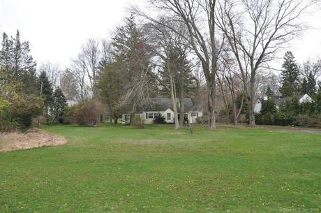 Single Family Home Sold in Westport CT 06880. Old  cape cod house near waterfront.