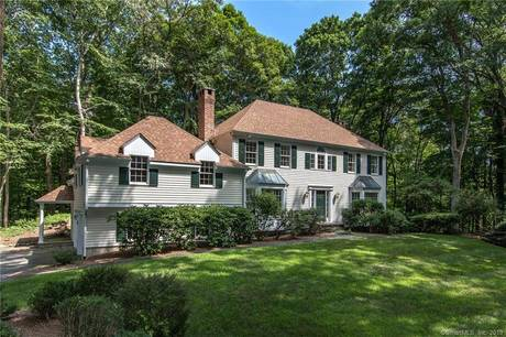Single Family Home For Sale in Wilton CT 06897. Colonial house near waterfront with 2 car garage.
