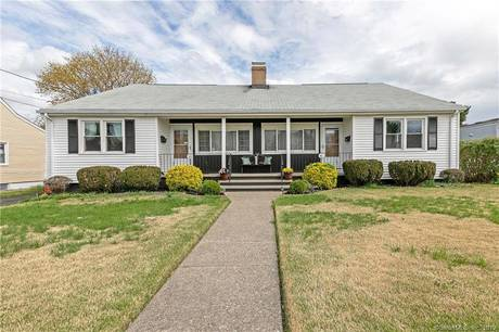 Multi Family Home Sold in Bridgeport CT 06610.  house near beach side waterfront with 2 car garage.