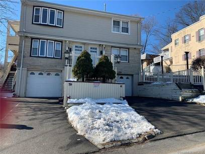 Multi Family Home Sold in Bridgeport CT 06606.  house near waterfront with swimming pool and 2 car garage.