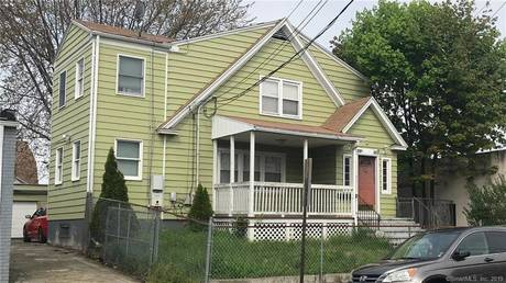 Multi Family Home Sold in Bridgeport CT 06610.  house near waterfront with 2 car garage.