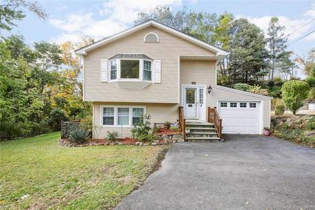 Single Family Home Sold in Danbury CT 06811. Ranch house near beach side waterfront with 2 car garage.