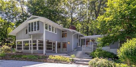 Single Family Home Sold in Westport CT 06880. Contemporary house near waterfront with swimming pool and 2 car garage.