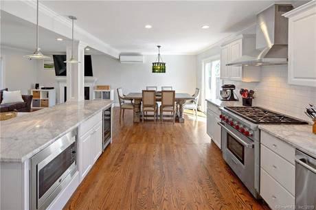 Single Family Home Sold in Greenwich CT 06831. Colonial cape cod house near waterfront with 2 car garage.