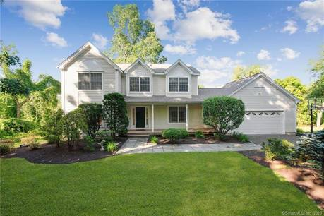 Single Family Home For Sale in Brookfield CT 06804. Colonial house near beach side waterfront with 2 car garage.