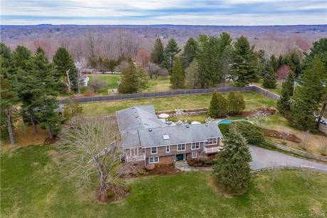 Single Family Home Sold in Weston CT 06883. Contemporary house near beach side waterfront with swimming pool and 2 car garage.