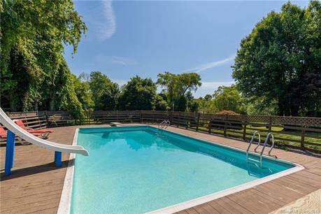 Single Family Home Sold in New Fairfield CT 06812. Ranch house near waterfront with swimming pool and 3 car garage.