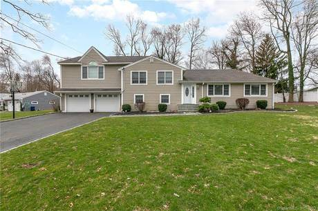 Single Family Home Sold in Norwalk CT 06851.  house near waterfront with swimming pool and 2 car garage.