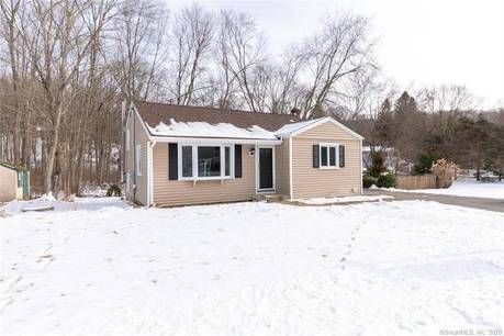 Single Family Home For Sale in Monroe CT 06468.  house near waterfront with 1 car garage.