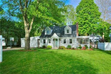 Single Family Home Sold in Fairfield CT 06824.  cape cod house near beach side waterfront with 2 car garage.