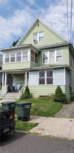 Short Sale: Multi Family Home Sold in Bridgeport CT 06606. Old  house near waterfront with 2 car garage.