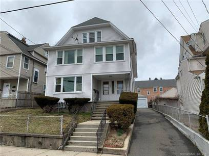 Multi Family Home Sold in Bridgeport CT 06606. Old  house near waterfront with 3 car garage.