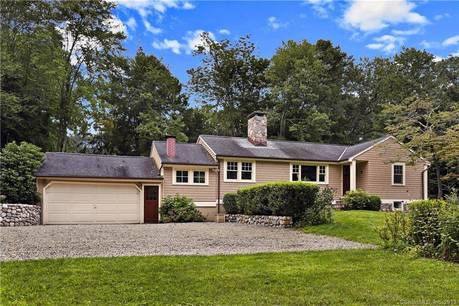 Single Family Home Sold in Weston CT 06883. Ranch house near waterfront with 2 car garage.